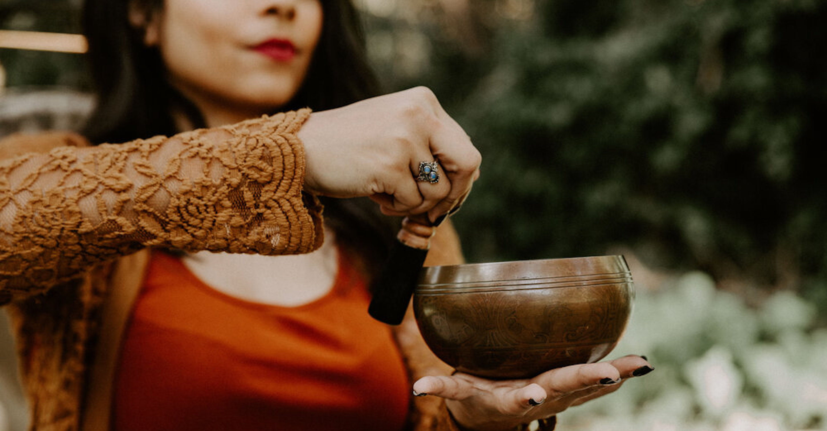 woman with copper sound healing bowl