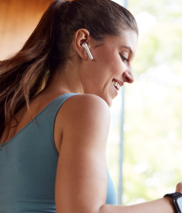 Woman exercising with headphones