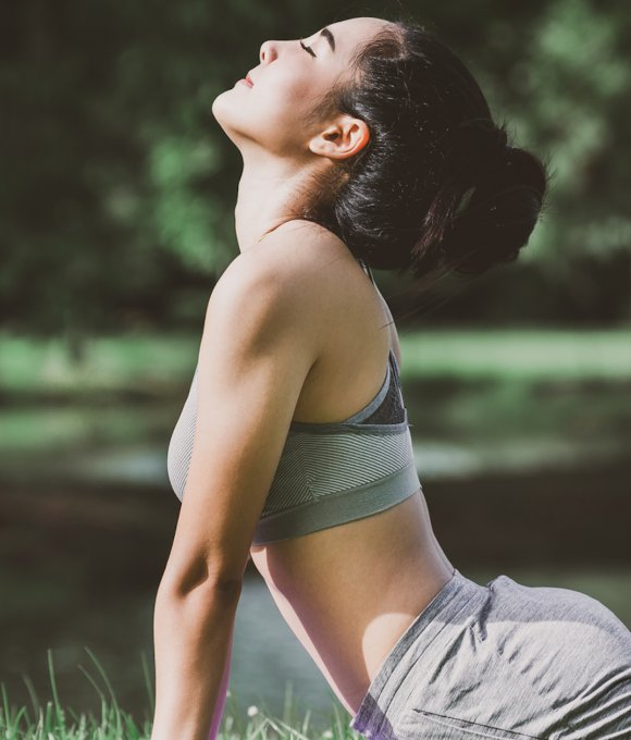 Young Woman in Upward Dog Yoga Pose