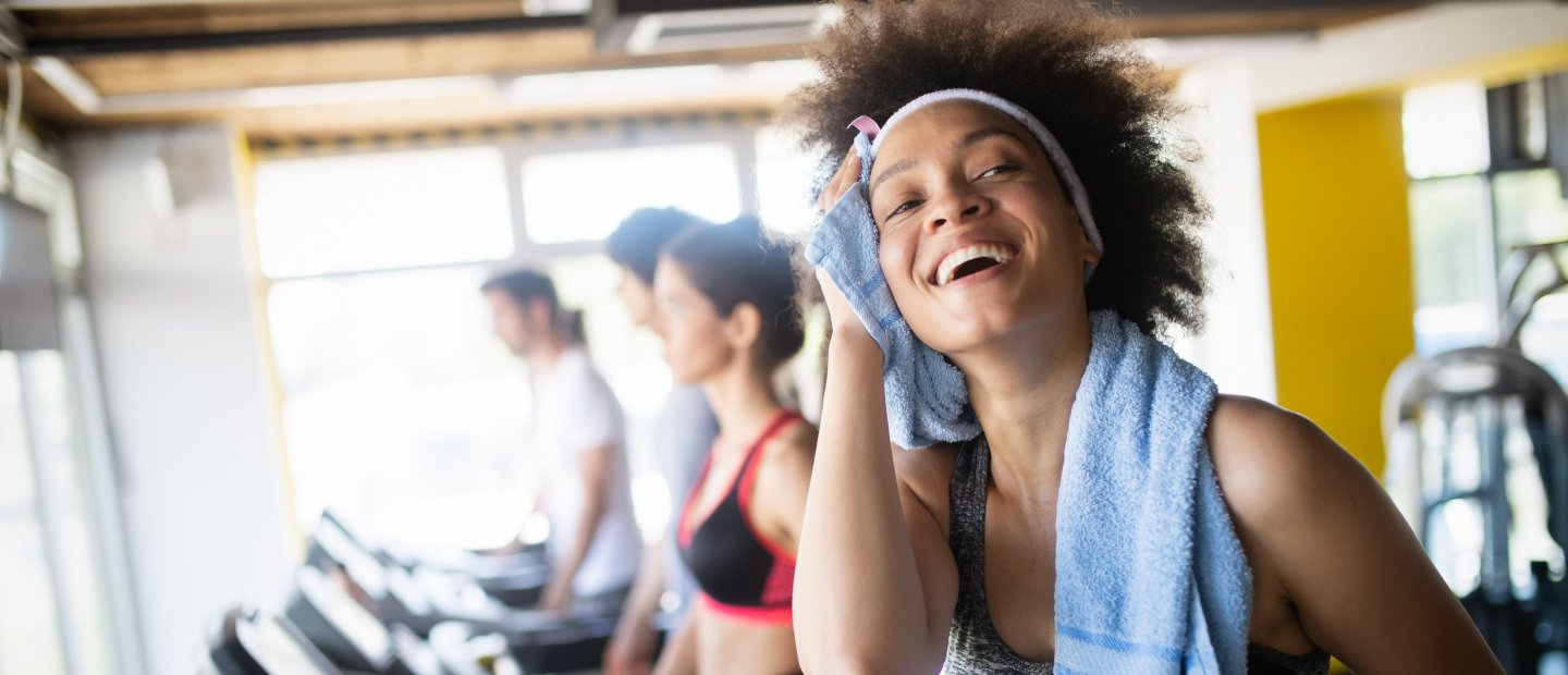 Woman sweating at gym