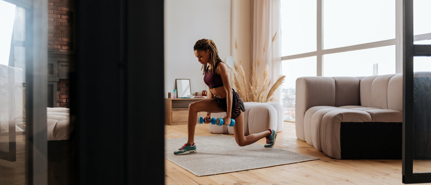 Young woman working out in livingroom