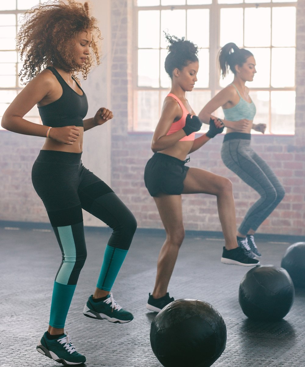 Women working out with steps in the gym