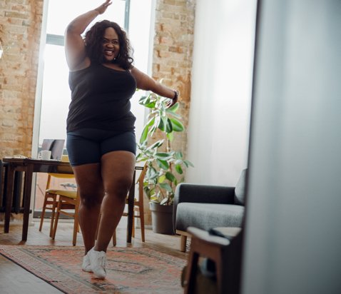 Woman dancing in living room