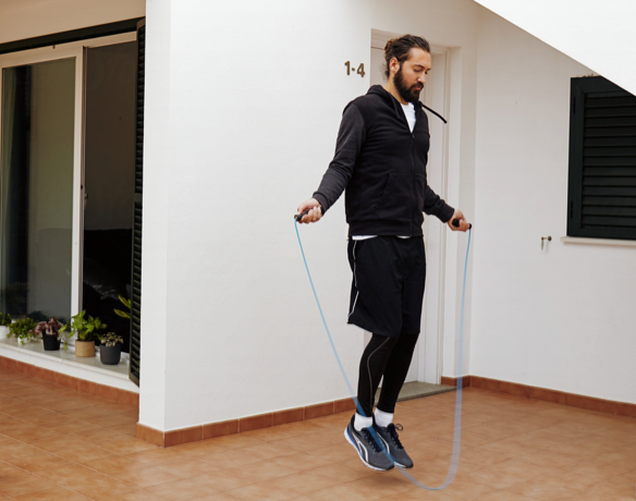 Man using jump rope indoors