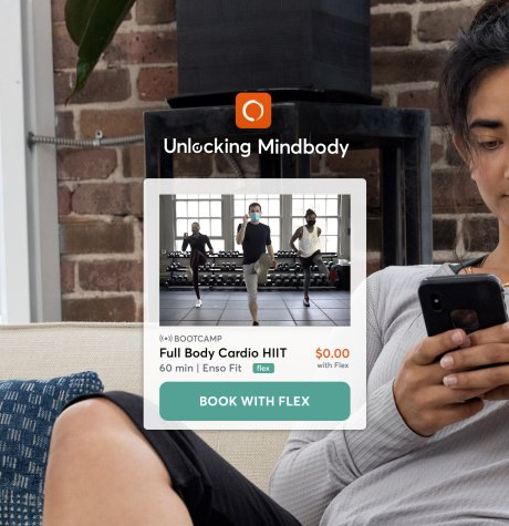 person on phone using mindbody flex